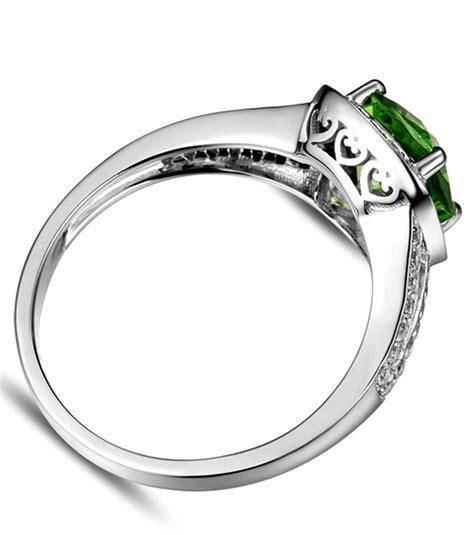beautiful 2 carat cushion cut emerald and halo