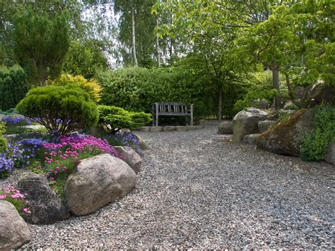 laying gravel in backyard gravel patio ideas