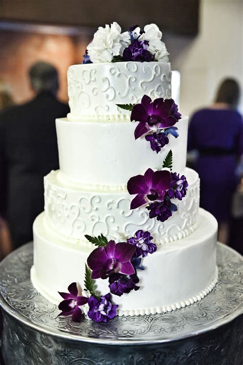 wedding cake photography white and purple wedding cake with cascading purple