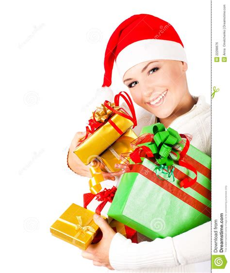 happy santa girl holding christmas gifts stock photo