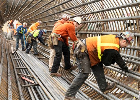 steel workers forming a rebar cage steel workers form a