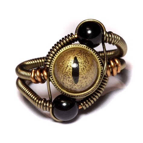 steunk ring gold and black by catherinetterings on