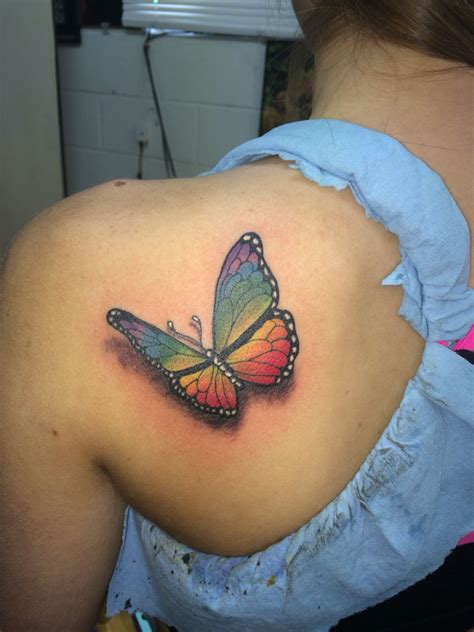 got ink tattoos realistic rainbow colored butterfly done by ricky