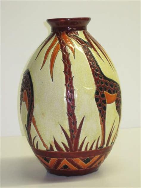 Giraffe Vase by Giraffes And Vase On