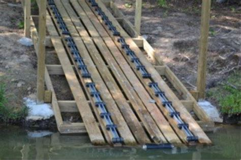 pontoon boat trailer rollers could roller bunks be used for flat bottomed pontoon to