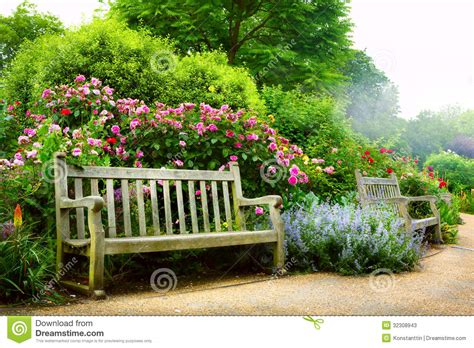 english park bench art bench and flowers in the morning in an english park stock photos image 32308943