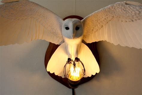 owl wall light handmade from paper resin and by zackmclaughlin