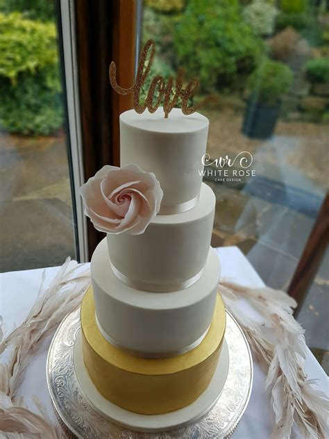 design cake maker four tier ivory blush and gold wedding cake by white rose