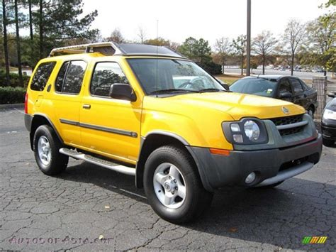 nissan yellow nissan xterra 2004 off road image 213