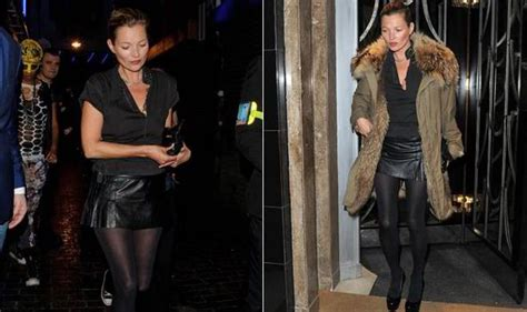 kate moss shows model pins in tiny leather skirt as she