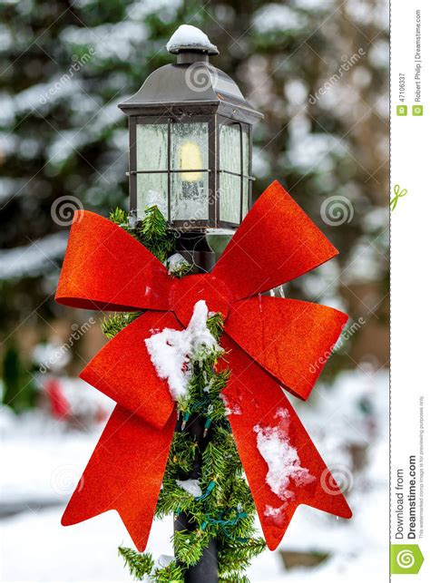 outdoor christmas l post decoration red holiday ribbon on a yard light stock image image