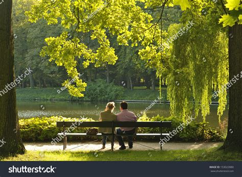 people sitting on a park bench two people sitting on the bench in the park stock photo 153022880 shutterstock