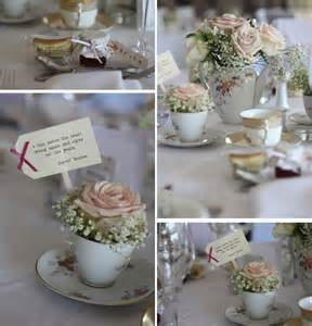 afternoon tea themed wedding pale ringed with babys breath perched in teacup