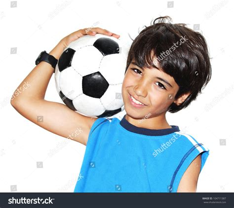 mottoki preteen boy cute boy playing football happy child stock photo