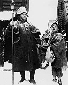 HARRY SECOMBE AS MR. BUMBLE, MARK LESTER AS OLIVER TWIST