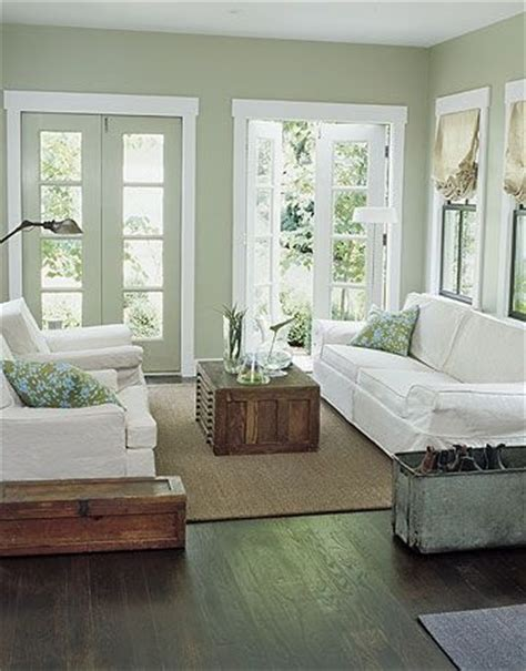 the light green wall color w the wood floors light sofas family room
