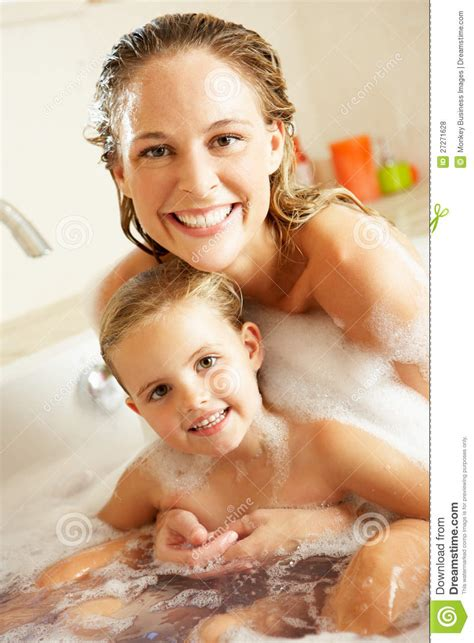 daughter in bathtub mother and daughter relaxing in bubble filled bath royalty