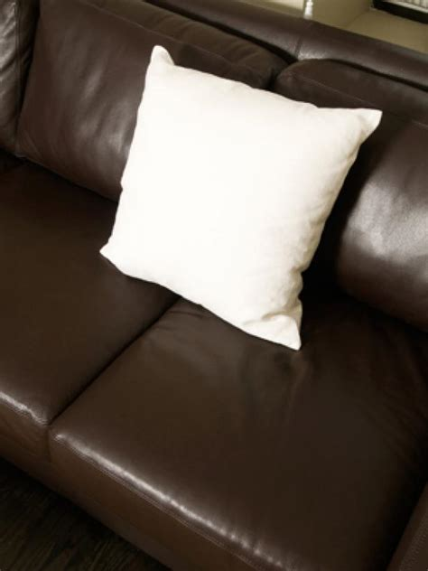 pillows on a leather couch buying leather furniture hgtv
