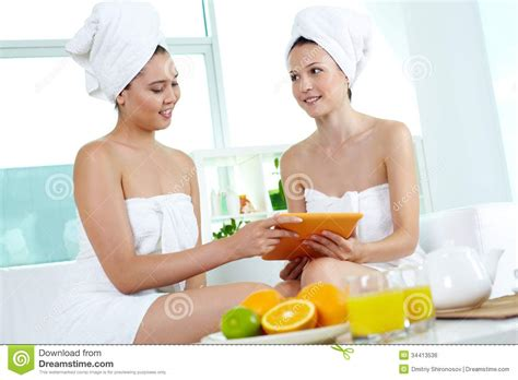 two girls in a bathtub using touchpad royalty free stock image image 34413536