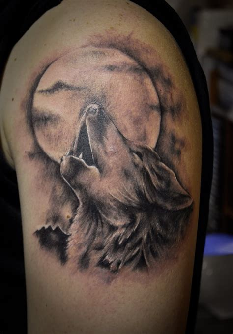 Howling Wolf And Moon Tattoo On Half Sleeve Wolf With Moon Tattoos