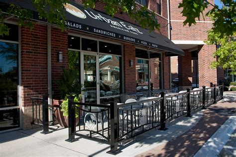 design coffee shop outdoor outdoor cafe seating with metal fencing depicting the logo