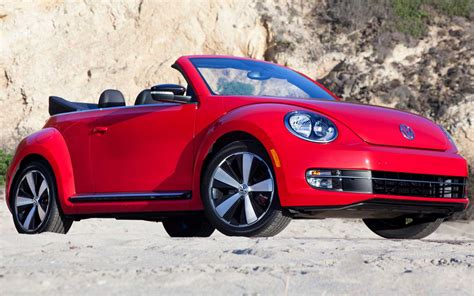 red volkswagen beetle watch a skydiver jump into a volkswagen beetle convertible