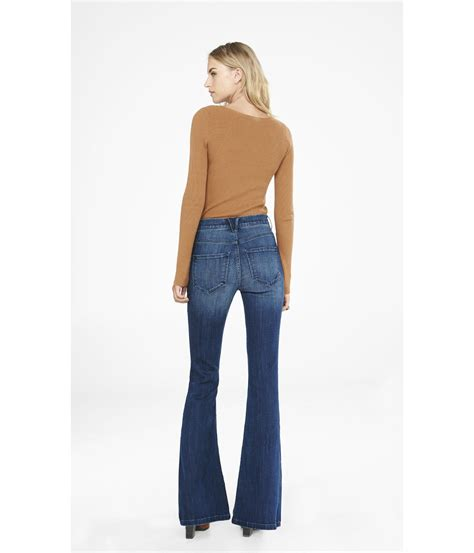 12 Helping Usher The Return Of The Flarebell Bottom by Express High Waisted Button Fly Bell Flare Jean In Blue Lyst