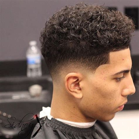 skin tight fade ponytail 18 best stylish curly hairstyles for men images on