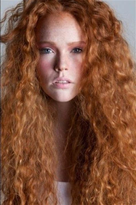 redheaded long hairstyle with semi spiral curls beautiful long curly redhead red hairstyles for women