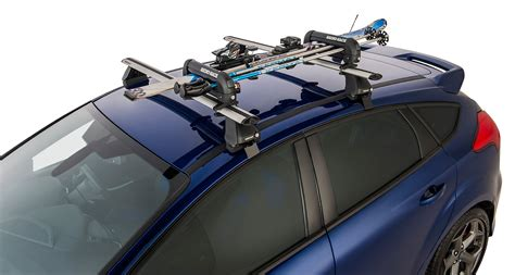 how to attach snowboard to roof rack ski carrier and fishing rod holder holds 2 skis or 1 snowboard 572 rhino rack