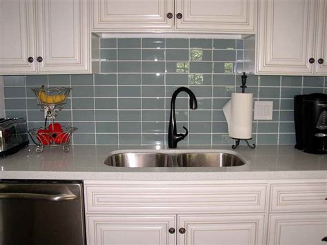 kitchen black faucet gray subway tile backsplash gray