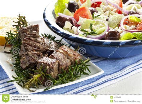 lamb kebabs and greek salad lamb kebabs with greek salad stock photography image