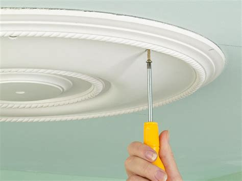 How To Attach A Light Fixture How To Install A Ceiling Medallion Above A Light Fixture How Tos Diy