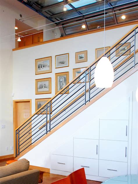 stair to lower level with storage cabinets below