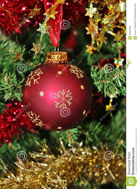 christmas decorations for tree in gold glitter and red