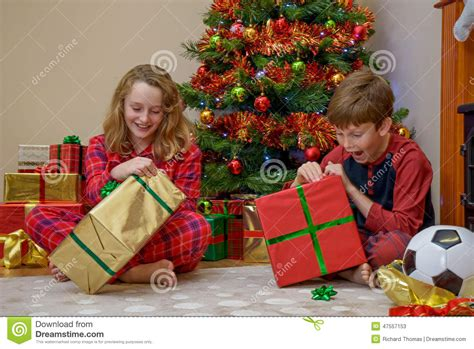 children opening christmas presents stock photo image