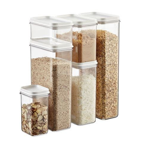 set of narrow stackable canisters with white lids the