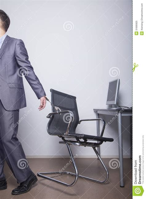 Handcuffed Chair by Businessman Handcuffed To His Office Chair Walking Away