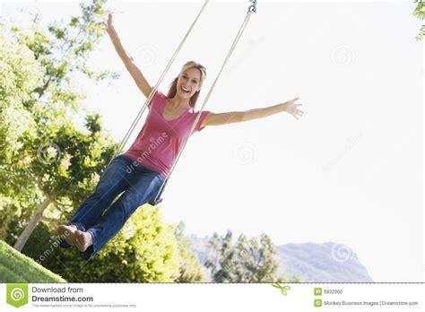 swing women woman on tree swing smiling stock photo image 5932300