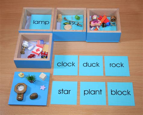 card materials blue wooden boxes with objects and word cards e o montessori