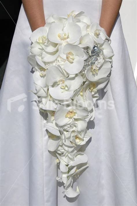 wedding bouquet lilies and orchids white orchid calla cascading