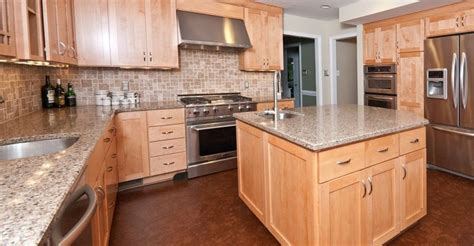 quartz countertops with maple cabinets under range hood natural maple shaker style
