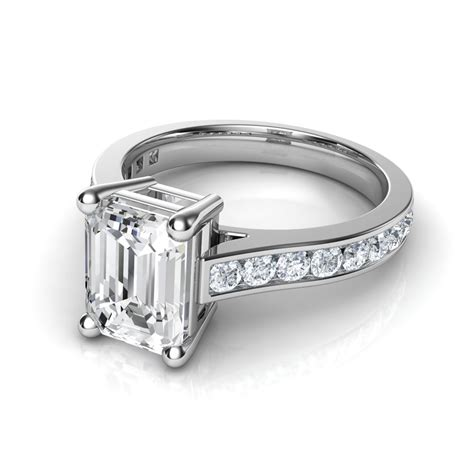 channel set cathedral emerald cut engagement ring