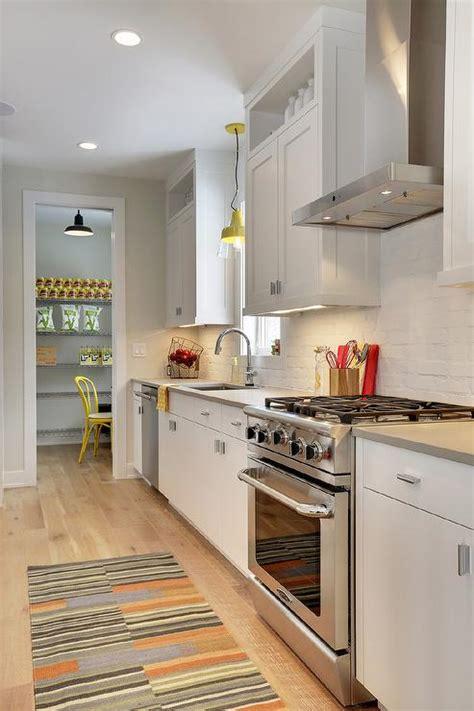 this inviting kitchen features flat front white cabinets white flat front cabinets with light gray quartz