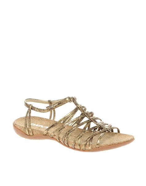 gold strappy flat sandals dkny active kallipso strappy flat sandals in gold lyst