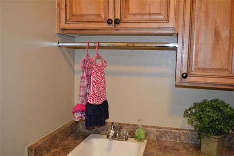 How High To Hang Closet Rod by Hanging A Custom Closet Rod In The Laundry Room I Am