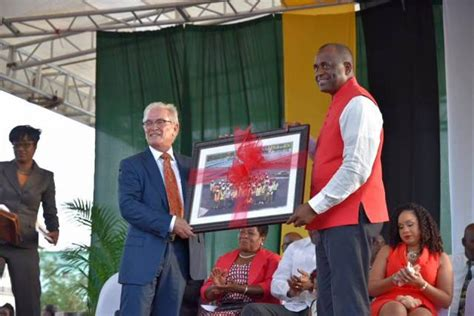 design management ltd dominica pm defends decision to award contract to bajan company