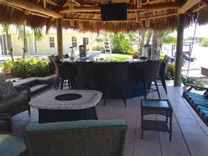 Tiki Hut Outdoor Kitchen And Landscaping Tropical Patio Fireplace Table