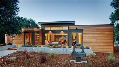 eco friendly prefab homes designs with garden and pathways