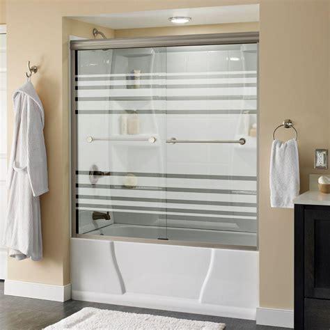 delta lyndall       semi frameless sliding bathtub door  nickel  transition